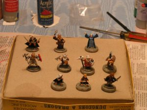 Partially painted miniature figures