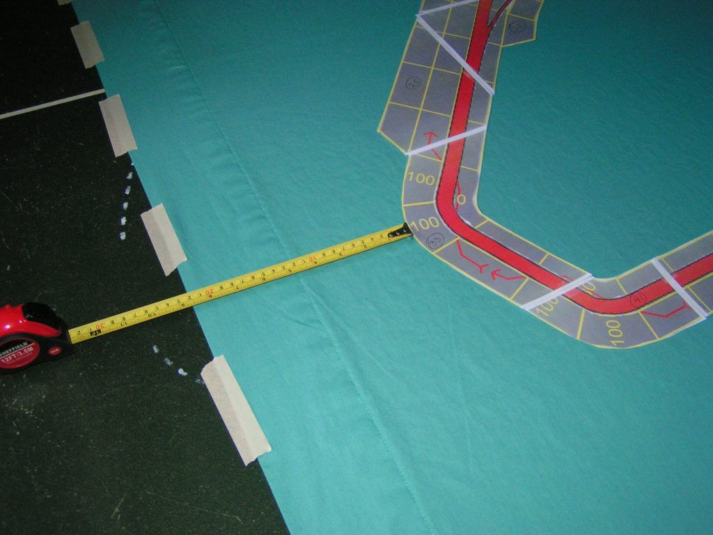 Measuring from the edges to center the track on the sheet.