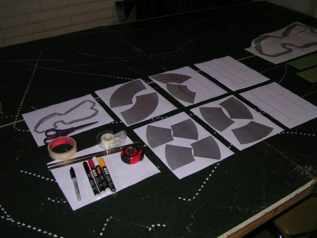 Track building items laid out on the table.