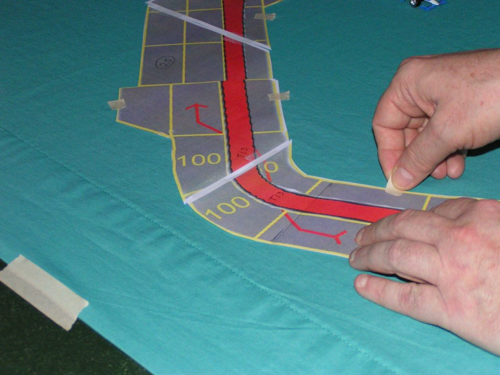 Taping the sections of the track.