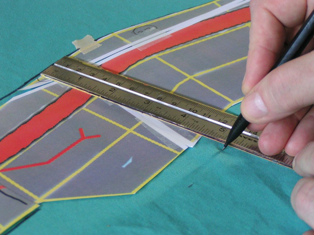 Using a ruler to check the track width.