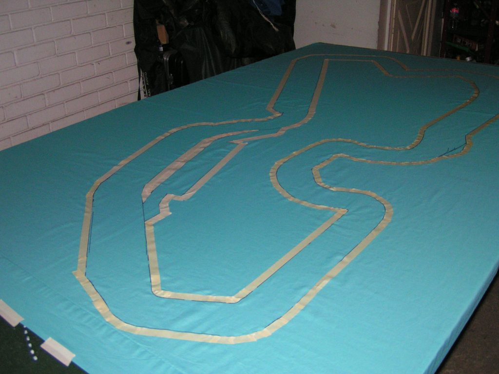 The track outline has been masked with tape.