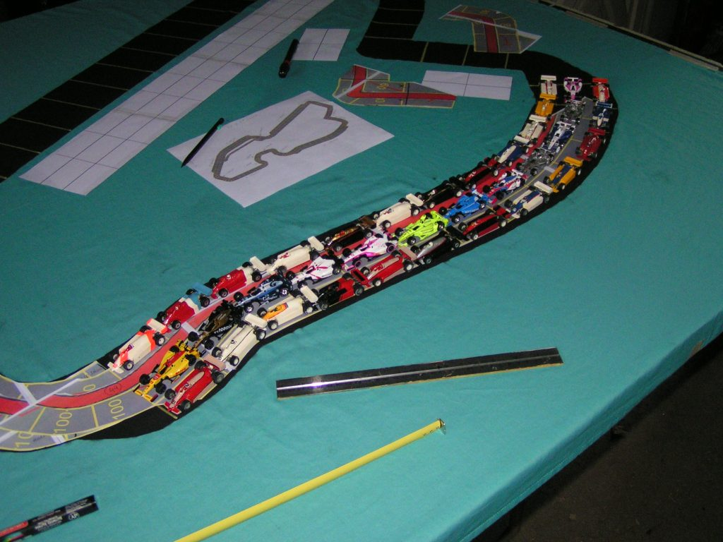 Using scale cars to determine track spaces on a curvy section of the track.