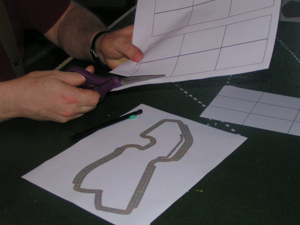 Cutting out paper straight-section templates.