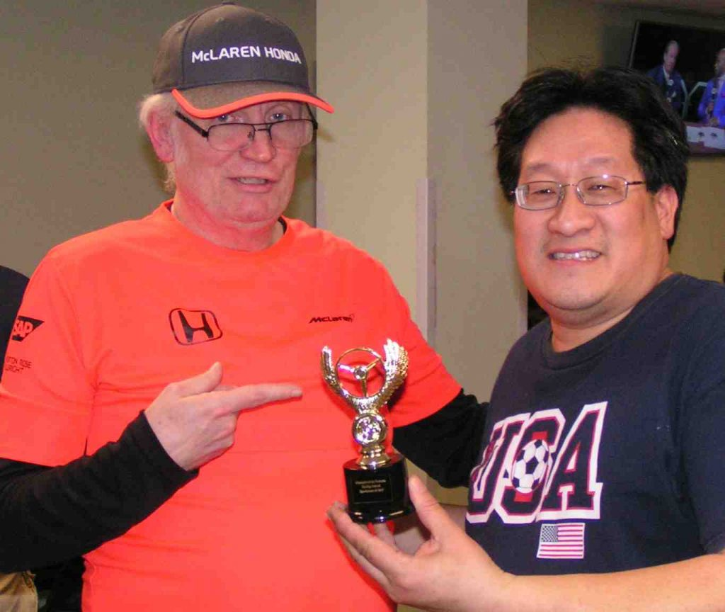 Greg Lim receives the Tom Kane trophy